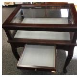Glass top display cabinet with cabriole legs