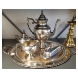 Group of silverplate and brass candleholder