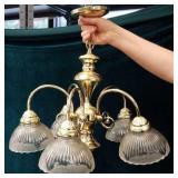 Brass tone chandelier
