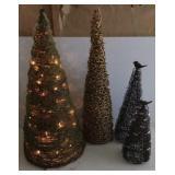 Quartet of small decorative Christmas trees