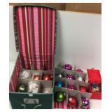 Christmas ornaments, lights, and storage bin