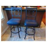 Pair of swiveling iron framed bar stools