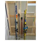 2 sets of skis and poles