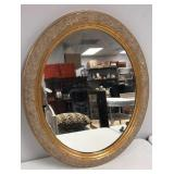 Gilt framed oval wall mirror