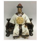 Asian themed ceramic man on bench