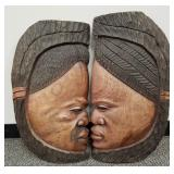 Pair of carved wooden art faces