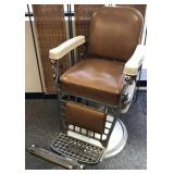 Vintage barber chair by Emil J. Paidar Company