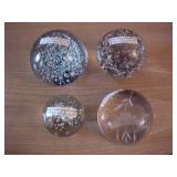 Four Clear Glass Paper Weights