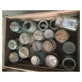 Blue jars in old crate