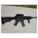 Bushmaster Corbon 15, 5.56 Cal. Auto., 30 Round Mag. W/Red Dot