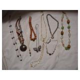 Eleven costume jewelry necklaces