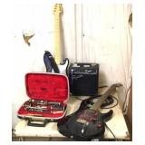 Cort guitar, cable, Squier amp, woodwind, toy
