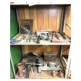jacks, pipe wrenches,brace bits, all on 2 shelves