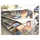 frames, pictures & decor on 2 shelf sections