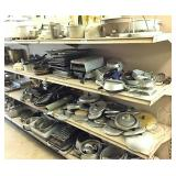 misc metal pans on 2 shelf sections
