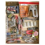 box of top rivets, fence pliers, crescent wrenches