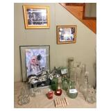 pictures on wall, tractor pictures, old bottles,