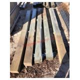 5 green treated posts, buying one money. Item is l