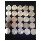 A lot of 25 nicer Peace silver dollars