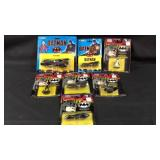 lot of seven Ertle Diecast cars and figures