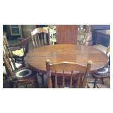 Heavy wooden table with leaf and four chairs