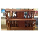 Two sets of wooden twin bed frames