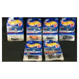 Lot of six hot wheels cars on cards