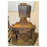 Wood stove w/ magic Heat, cooking grate inside,