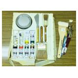 Art supply set with oil and water color paints.
