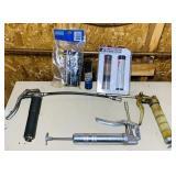 3 grease guns and 4 tubes