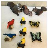 Yard items ( birds and butterflies appear  to