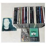 22 Assorted CDs   2- Tapes