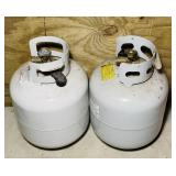 2 propane Tanks, 20#, new style, 1 has some in it