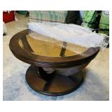 Nice Round Coffee Table on Wheels, Amber glass,