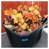Tote of artificial fall flowers and leaves