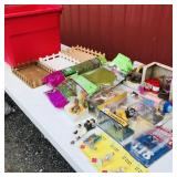 Tote of plastic figurines/ fake grass/wooden