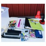 Tote of office supplies and two desk lamps