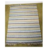 Green and blue woven rug