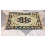 Blue and green floral rug