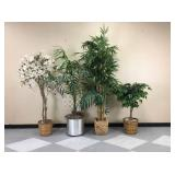 A collection of large artificial plants.