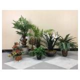 A collection of small artificial plants.
