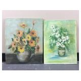A pair of small floral oil paintings.