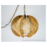A vintage woven hanging lamp