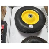 Pr of hard rubber tires and rims