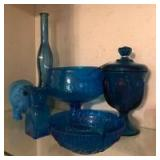 5 pieces of blue glass,