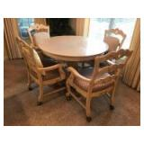 Very nice dining table with 4 arm chairs on rollers