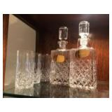 Two liquor decanters and three glasses