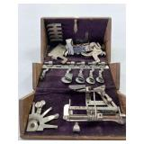 Vintage sewing machine attachments in Box