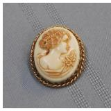 Cameo on conch shell brooch, 1.5 inches