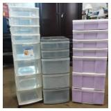 3 plastic storage cabinets, one on wheels, one